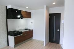 古いオフイスをシンプルデザインのマンションに改修写真